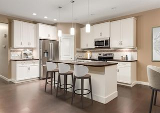 Photo 8: 150 AUTUMN Circle SE in Calgary: Auburn Bay Detached for sale : MLS®# A1089231