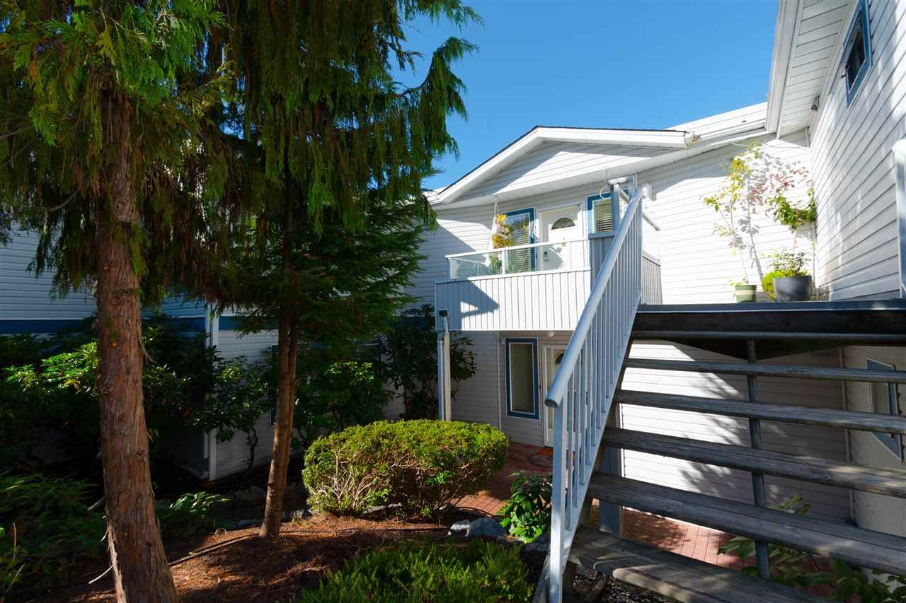 "Main Photo: 205 13863 100 Avenue in Surrey: Whalley Townhouse for sale in ""Odyssey"" (North Surrey)  : MLS®# R2356449"