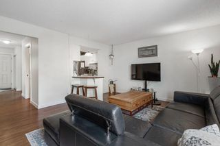Photo 4: 102 4810 40 Avenue SW in Calgary: Glamorgan Row/Townhouse for sale : MLS®# A1136264
