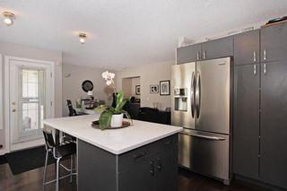 Photo 3: 150 SIERRA MORENA Green SW in Calgary: Signal Hill Semi Detached for sale : MLS®# C4294860