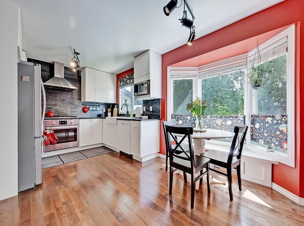 Photo 4: Photos: 7607 68 Avenue NW in Calgary: Silver Springs Detached for sale : MLS®# A1024824