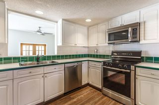 Photo 3: #34 5810 PATINA DR SW in Calgary: Patterson House for sale : MLS®# C4138541