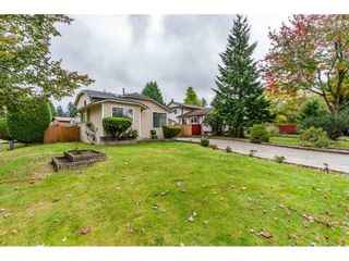 Photo 2: 6186 130 Street in Surrey: Panorama Ridge House for sale : MLS®# R2508593