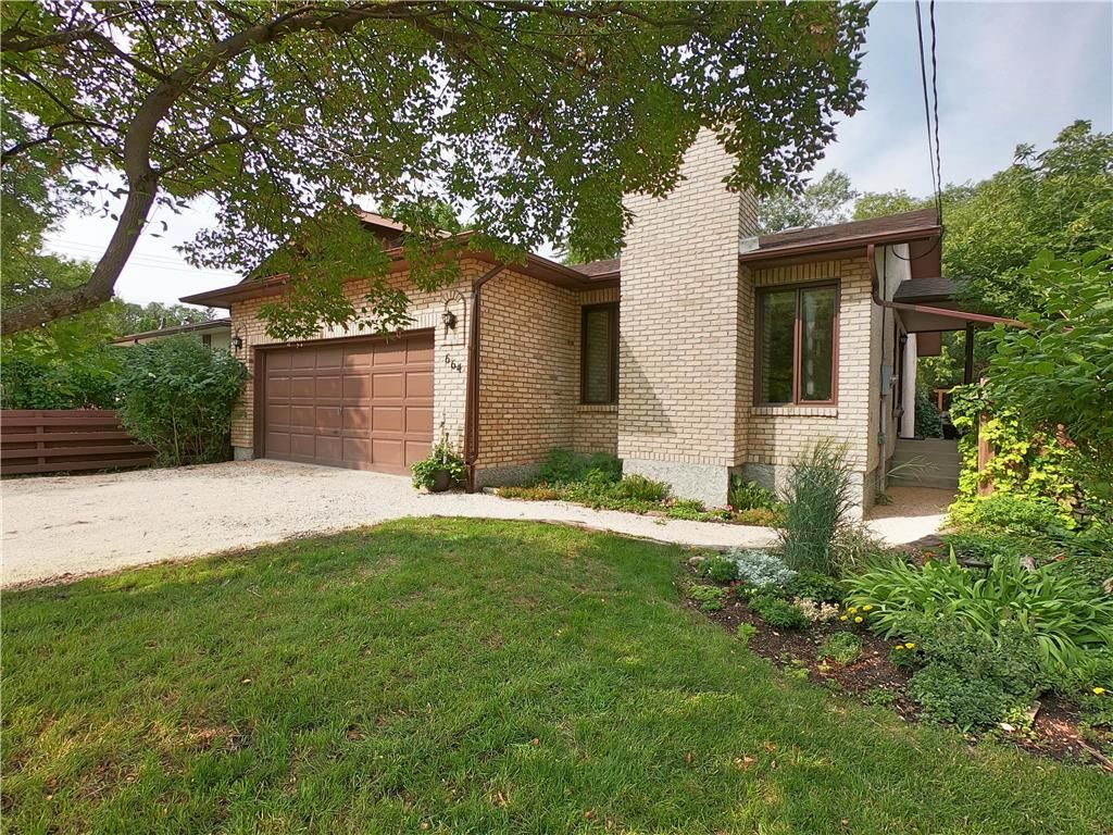 Straight, Solid & Spacious 21 year owner Charleswood Home on a private & fully treed lot!