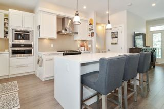 """Photo 2: 82 7665 209 Street in Langley: Willoughby Heights Townhouse for sale in """"ARCHSTONE"""" : MLS®# R2607778"""