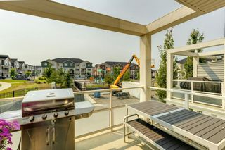 Photo 30: 912 Redstone View NE in Calgary: Redstone Row/Townhouse for sale : MLS®# A1136349