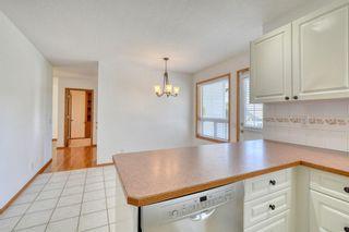Photo 18: 12 West Hall Place: Cochrane Detached for sale : MLS®# A1119224