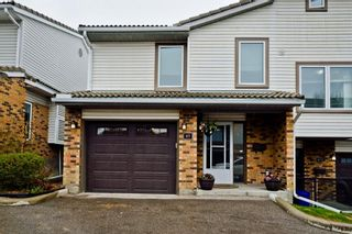 Photo 2: 85 Coachway Gardens SW in Calgary: Coach Hill Row/Townhouse for sale : MLS®# A1110212