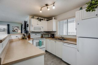 Photo 4: 4415 604 8 Street SW: Airdrie Apartment for sale : MLS®# A1049866