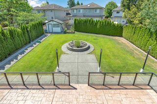 """Photo 29: 7439 146 Street in Surrey: East Newton House for sale in """"Chimney Heights"""" : MLS®# R2602834"""