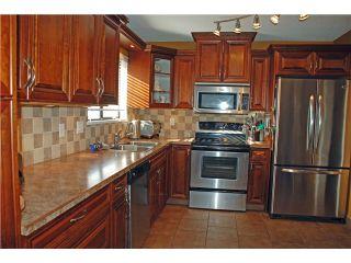Photo 4: 1556 WESTMINSTER AV in Port Coquitlam: Glenwood PQ House for sale : MLS®# V1047874