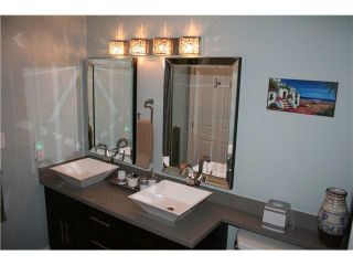 """Photo 11: 105 3600 WINDCREST Drive in North Vancouver: Roche Point Townhouse for sale in """"RAVEN WOODS"""" : MLS®# V1101013"""