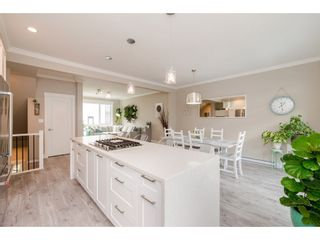 """Photo 11: 209 16488 64 Avenue in Surrey: Cloverdale BC Townhouse for sale in """"Harvest"""" (Cloverdale)  : MLS®# R2376091"""