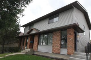 Photo 1: 38 EDGEDALE Court NW in Calgary: Edgemont Semi Detached for sale : MLS®# A1141906