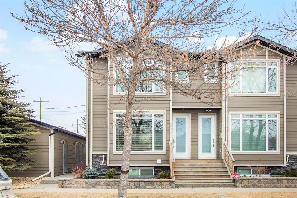 Main Photo: 1306 2 Street NE in Calgary: Crescent Heights Row/Townhouse for sale : MLS®# A1079019