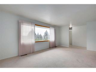 Photo 7: 3039 CANMORE Road NW in Calgary: Banff Trail House for sale