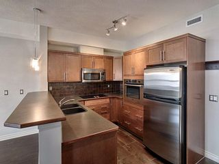 Photo 7: 307 26 Val Gardena View SW in Calgary: Springbank Hill Apartment for sale : MLS®# A1107020