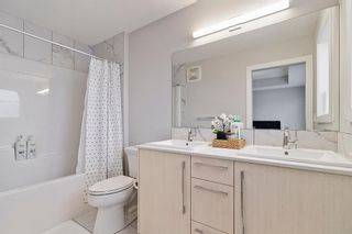 Photo 12: 84 Red Embers Place NE in Calgary: Redstone Semi Detached for sale : MLS®# A1080620