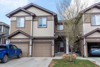 Photo 2: 17 8209 217 Street in Edmonton: Zone 58 Townhouse for sale : MLS®# E4255078