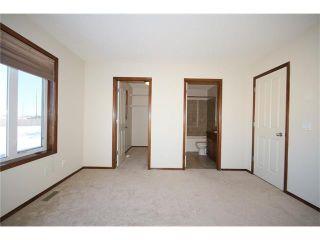 Photo 25: 103 WEST POINTE Court: Cochrane House for sale : MLS®# C4042878