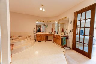 Photo 15: 126 Country Club Lane in Rural Rocky View County: Rural Rocky View MD Semi Detached for sale : MLS®# A1129942