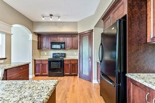 Photo 4: 122 Cimarron Drive: Okotoks Detached for sale : MLS®# C4266799