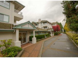 "Photo 1: 301 15272 20TH Avenue in Surrey: King George Corridor Condo for sale in ""WINDSOR COURT"" (South Surrey White Rock)  : MLS®# F1324967"