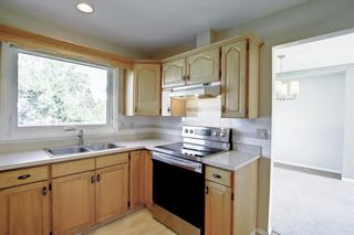 Photo 11: 216 Silver Springs Green NW in Calgary: Silver Springs Detached for sale : MLS®# A1147085