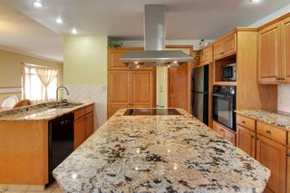 Photo 7: 4 Commerce Street NW in Calgary: Cambrian Heights Detached for sale : MLS®# A1103120