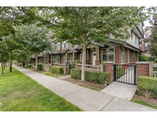 """Photo 2: 106 6655 192 Street in Surrey: Clayton Townhouse for sale in """"ONE 92"""" (Cloverdale)  : MLS®# R2492692"""