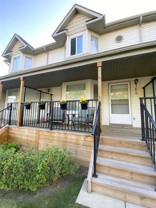 Main Photo: 68 Hidden Valley Link NW in Calgary: Hidden Valley Row/Townhouse for sale : MLS®# A1113980
