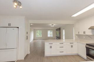 """Photo 4: 8960 URSUS Crescent in Surrey: Bear Creek Green Timbers House for sale in """"BEAR CREEK"""" : MLS®# R2608318"""
