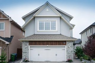 Main Photo: 48 Tremblant Terrace SW in Calgary: Springbank Hill Detached for sale : MLS®# A1131887