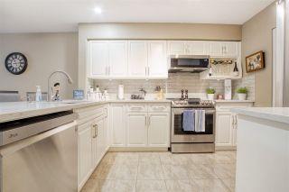 "Photo 12: 202 13860 70 Avenue in Surrey: East Newton Condo for sale in ""Chelsea Gardens"" : MLS®# R2526715"