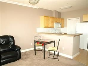 Photo 4: 2131 1010 ARBOUR LAKE Road NW in Calgary: Arbour Lake Apartment for sale : MLS®# C4254422