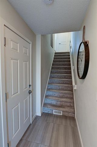 Photo 4: 13 Walden SE in Calgary: Walden Row/Townhouse for sale : MLS®# A1146775