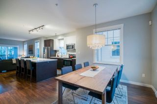 """Photo 3: 124 3010 RIVERBEND Drive in Coquitlam: Coquitlam East Townhouse for sale in """"WESTWOOD"""" : MLS®# R2233937"""