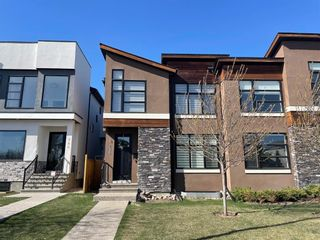 Main Photo: 236 25 Avenue NW in Calgary: Tuxedo Park Semi Detached for sale : MLS®# A1101749