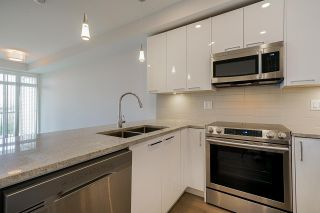"""Photo 3: 418 20696 EASTLEIGH Crescent in Langley: Langley City Condo for sale in """"The Georgia"""" : MLS®# R2574305"""