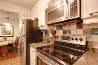 Photo 6: 106 819 4A Street NE in Regal Manor: Apartment for sale : MLS®# C3611396