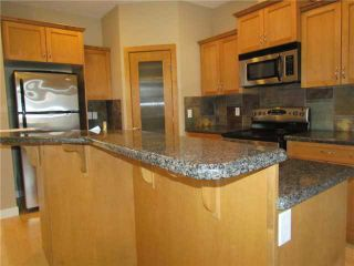 Photo 1: 1046 RUNDLE Crescent NE in CALGARY: Renfrew Regal Terrace Residential Attached for sale (Calgary)  : MLS®# C3506695