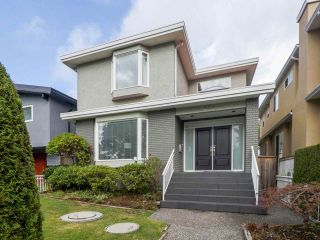 Photo 1: 869 W 63RD Avenue in Vancouver: Marpole House for sale (Vancouver West)  : MLS®# R2503413