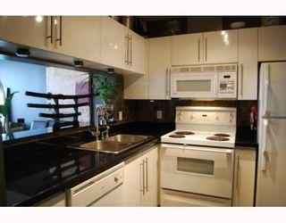"""Photo 4: 311 8420 JELLICOE Street in Vancouver: Fraserview VE Condo for sale in """"BOARDWALK"""" (Vancouver East)  : MLS®# V803299"""