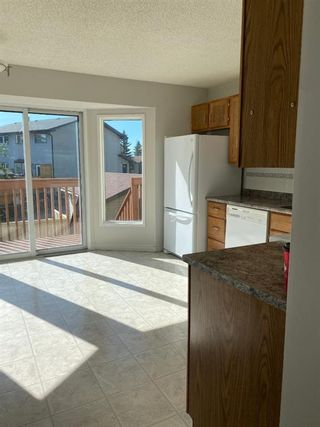 Photo 6: 554 STRATHCONA Drive SW in Calgary: Strathcona Park Semi Detached for sale : MLS®# A1020759