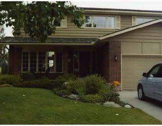 Photo 1: 44 WOODGREEN Crescent SW in CALGARY: Woodlands Residential Detached Single Family for sale (Calgary)  : MLS®# C3310866