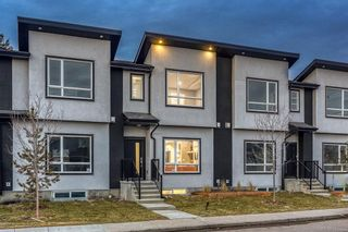Main Photo: 1911 42 Street in Calgary: Montgomery Row/Townhouse for sale : MLS®# A1054999