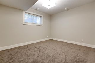 Photo 34: 105 Westland Crescent SW in Calgary: West Springs Detached for sale : MLS®# A1118947
