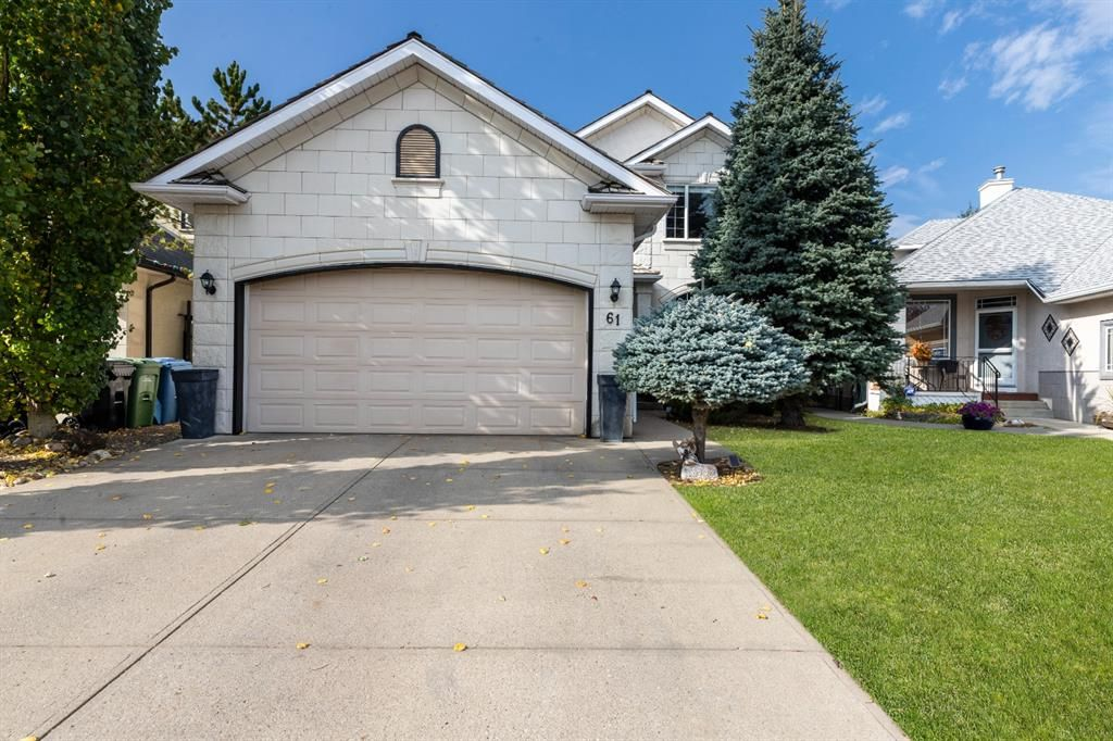 Main Photo: 61 Strathridge Crescent SW in Calgary: Strathcona Park Detached for sale : MLS®# A1152983