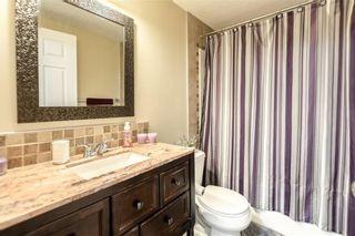 Photo 26: 325 BRIDLERIDGE View SW in Calgary: Bridlewood House for sale : MLS®# C4177139