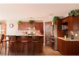 Photo 6: 48 COUGARSTONE Court SW in Calgary: Cougar Ridge House for sale : MLS®# C4045394